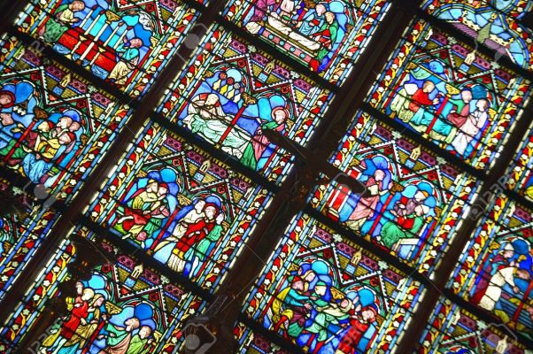 20512978-stained-glass-windows-inside-the-notre-dame-cathedral-paris-france